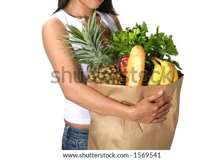 Woman taking in the groceries - stock photo