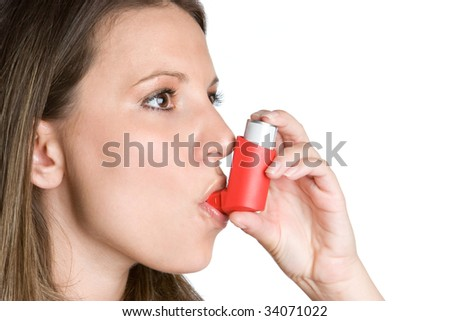 Woman Taking Inhaler - stock photo
