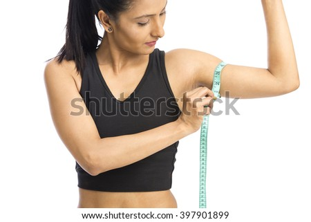 Woman taking measurements of arm over a white background - stock photo