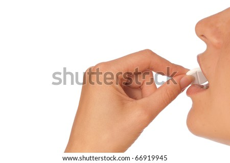 woman taking narcotic in a shape of white pill - stock photo
