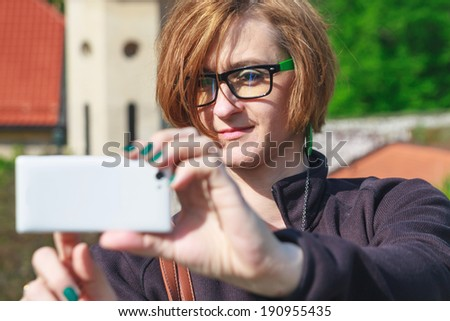 Woman taking photo with cellphone - stock photo