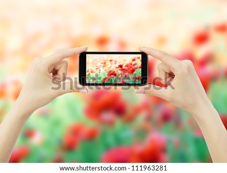 woman taking photo with mobile cell phone - stock photo
