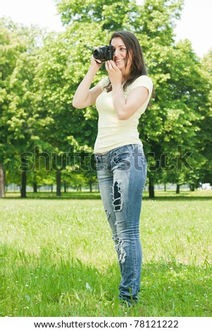 Woman taking photo with old fashioned camera. - stock photo