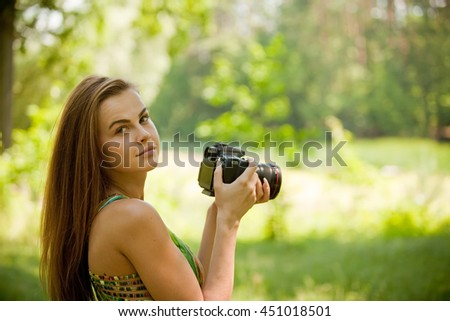 Woman taking pictures in sunny day
