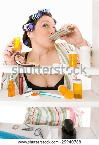 woman taking pills and drinking alcohol - stock photo