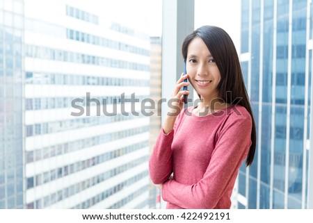 Woman talk to cellphone  - stock photo