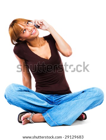 Woman talking on a mobile phone isolated over white - stock photo