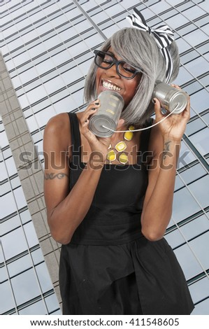 Woman talking on a primitive tin can phone