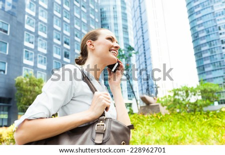Woman talking on cellphone - stock photo