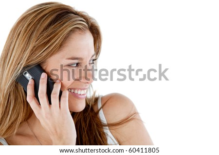 Woman talking on her mobile phone - isolated over a white background - stock photo