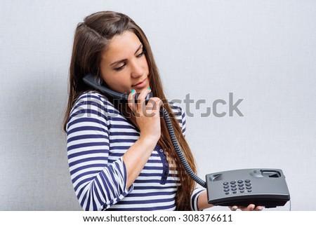 woman talking on landline phone - stock photo