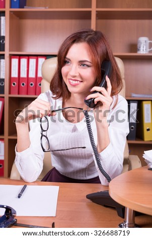 woman talking on phone with smile