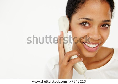 Woman talking on telephone - stock photo