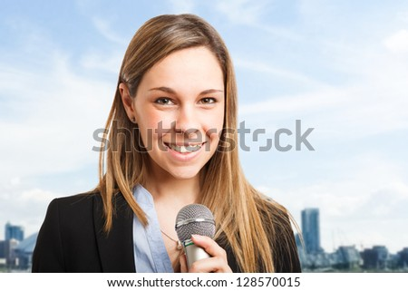 Woman talking on the microphone - stock photo