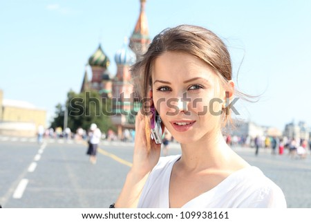 woman talking on the phone in Moscow near the Kremlin - stock photo