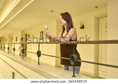 woman talking on the phone in the lobby of the building