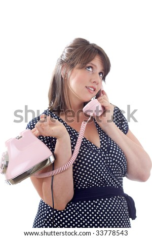 Woman talking on the telephone; isolated on a white background. - stock photo