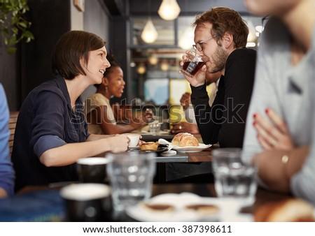 Woman talking to her boyfriend on a coffee date - stock photo