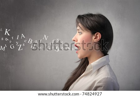 Woman talking with alphabet letters coming out of her mouth - stock photo