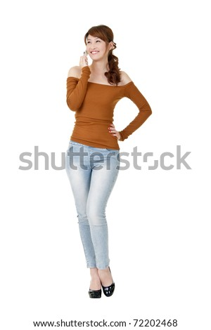 Woman talking with cellphone and smiling, full length portrait isolated on white background. - stock photo