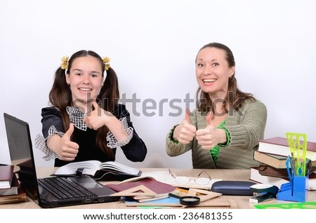 Woman teacher and schoolgirl teenager are happy successful learning