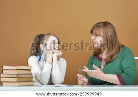 Woman teaches a ten-year girl.  - stock photo