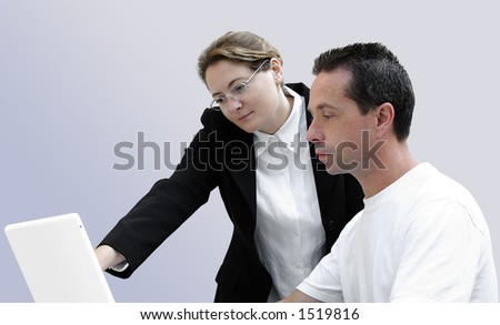 Woman teaching computing to a learning adult. - stock photo
