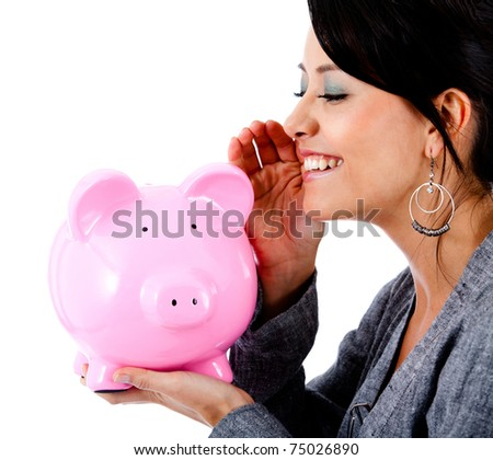 Woman telling a financial secret to a piggybank - isolated