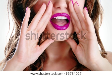 Woman telling a secret - stock photo