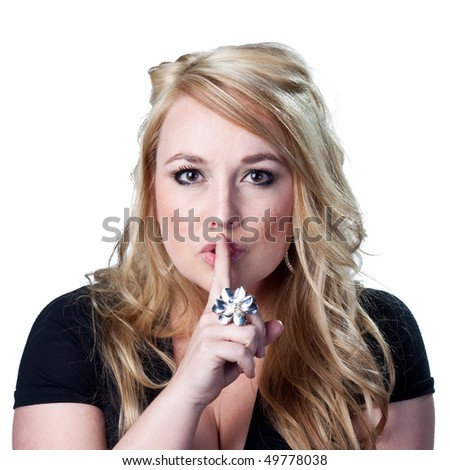 Woman telling people to be quiet. - stock photo