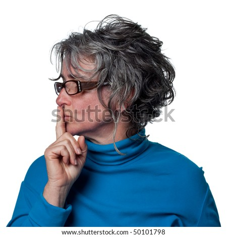 Woman telling people to be quiet, finger on lips - stock photo