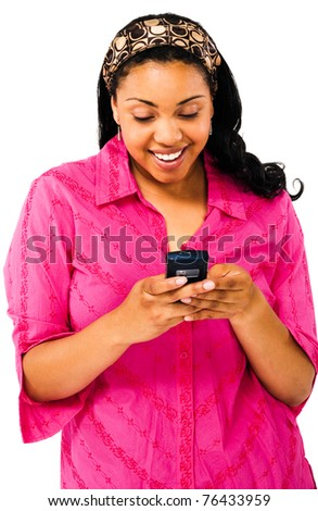 Woman text messaging on a mobile phone and smiling isolated over white