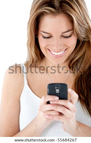Woman texting on her cell - isolated over a white background - stock photo