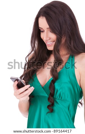 Woman texting on her cell isolated over a white background - stock photo