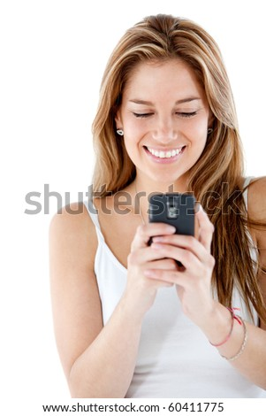 Woman texting on her mobile phone - isolated over a white background - stock photo