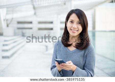 Woman texting on phone  - stock photo