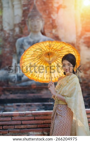 Woman thai wearing typical thai dress with thai identity culture at Ayutthaya in Thailand - stock photo