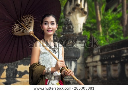 Woman thai wearing typical thai dress with thai identity culture at Phayao in Thailand - stock photo