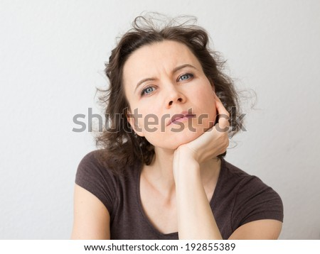 Woman thinkig about seriously - stock photo