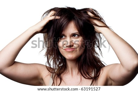Woman thinking about her hair - stock photo