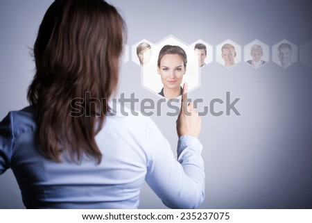 Woman thinking about important people in her life - stock photo
