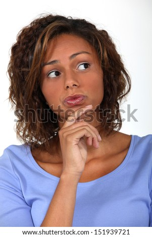woman thinking and holding her chin - stock photo