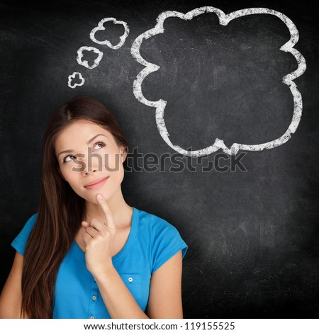 Woman thinking blackboard concept. Pensive girl looking at thought bubble on chalkboard / blackboard texture background. Mixed race Asian Chinese / Caucasian student. - stock photo