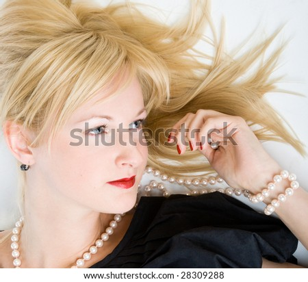 Woman thinking in a relaxed pose. Isolated on white background - stock photo