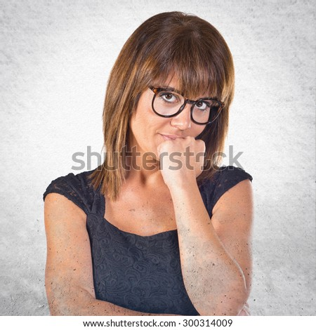 Woman thinking over grey background - stock photo
