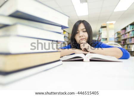 Woman thinking something in the library