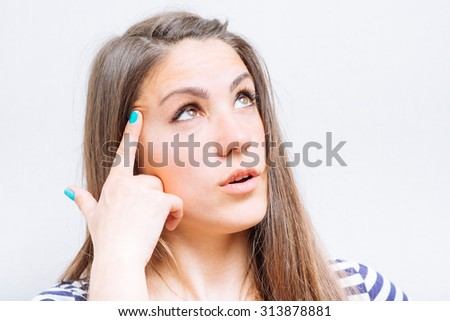 woman thinking, trying hard to remember something - stock photo