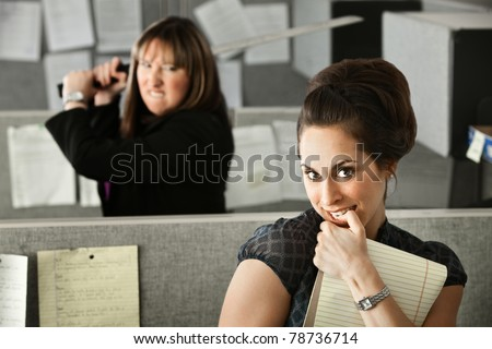 Woman threatens to stab coworker with Samurai sword - stock photo