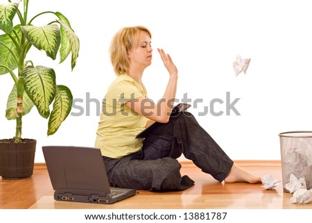 Woman throwing away a crumpled piece of paper - concept for working hard but without productivity - stock photo