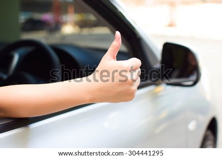 woman thumbs up for good car